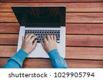 close up cropped of hands on... | Shutterstock . vector #1029905794