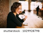 smiling young woman with cup of ... | Shutterstock . vector #1029928798