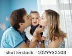 baby girl playing with parents. ... | Shutterstock . vector #1029932503