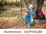 tourists with backpacks and map ... | Shutterstock . vector #1029936280
