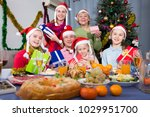 family is posing with gifts in... | Shutterstock . vector #1029951700