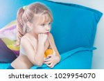 little blonde girl with painted ... | Shutterstock . vector #1029954070