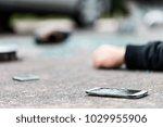 broken phone lying on the... | Shutterstock . vector #1029955906