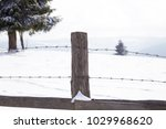 old wooden fence in winter... | Shutterstock . vector #1029968620