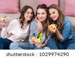 beautiful young women eating...   Shutterstock . vector #1029974290
