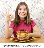 happy little girl with... | Shutterstock . vector #1029989440