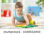 toddler boy playing indoors... | Shutterstock . vector #1030016443