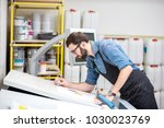 worker checking the quality of... | Shutterstock . vector #1030023769