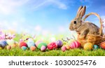 Stock photo little bunny in basket with decorated eggs easter card 1030025476