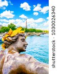 Small photo of Seine river photo and city view from Bridge Alexander III, Paris, France