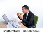 business man eat noodle on the... | Shutterstock . vector #1030026868