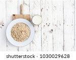 oatmeal  rolled oats on white... | Shutterstock . vector #1030029628