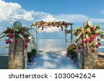 beautiful wedding on the beach. ... | Shutterstock . vector #1030042624