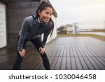 smiling young asian woman in... | Shutterstock . vector #1030046458
