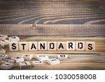 standards. wooden letters on... | Shutterstock . vector #1030058008