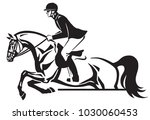 Horse And Rider Jumping Over A...
