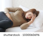 young asian woman in pain with... | Shutterstock . vector #1030060696