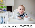 cute little baby boy  eating... | Shutterstock . vector #1030070290