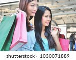 two girl friends  holding... | Shutterstock . vector #1030071889