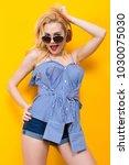 girl in blouse with headphones... | Shutterstock . vector #1030075030