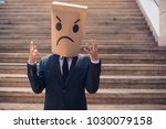 business man holding a paper... | Shutterstock . vector #1030079158