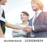 businesspeople  shaking hands... | Shutterstock . vector #1030084834
