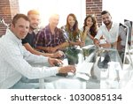 young business team sitting at... | Shutterstock . vector #1030085134