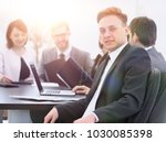 business team with a senior... | Shutterstock . vector #1030085398
