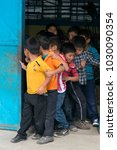 Small photo of GUATEMALA, QUETZALTENANGO - January 30, 2016. Group of young children lining up in public school in Guatemala, Central America, Latin America. EDITORIAL.