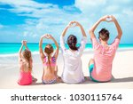 happy beautiful family of four... | Shutterstock . vector #1030115764