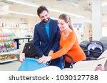 couple in baby shop buying...   Shutterstock . vector #1030127788
