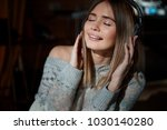 fashion young model listen... | Shutterstock . vector #1030140280