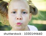 excited face of pretty small... | Shutterstock . vector #1030144660