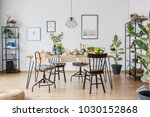 chairs at table with food in... | Shutterstock . vector #1030152868