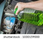 Small photo of Add up windshield wiper summer fluid in car