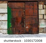 rusty garage door. grunge... | Shutterstock . vector #1030172008