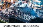 pedestrians cross the shibuya... | Shutterstock . vector #1030185859