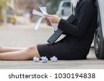 Small photo of Businesswoman sits and holding folder of document file with reading letter cancel a job. Failure and lack of morale. Soft focus and blur. Copy space.