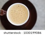 top view a cup of cappuccino in ...   Shutterstock . vector #1030199086