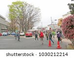 blurred people cross the... | Shutterstock . vector #1030212214