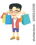 asian boy holding many shopping ... | Shutterstock .eps vector #1030213330