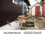 table with chairs at back yard... | Shutterstock . vector #1030215610