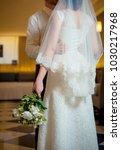 bride and groom a hug | Shutterstock . vector #1030217968