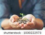 man in black shirt holding... | Shutterstock . vector #1030222573