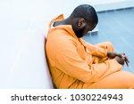 Sad African American Prisoner...