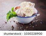 garlic cloves and garlic bulb... | Shutterstock . vector #1030228900