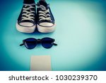 sneakers and glasses on a blue... | Shutterstock . vector #1030239370