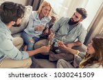 happy friends drinking wine and ... | Shutterstock . vector #1030241509