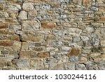 closeup aged cobblestone... | Shutterstock . vector #1030244116