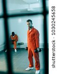 prisoner training with... | Shutterstock . vector #1030245658